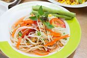 stock photo of thai food  - Thai papaya salad or Som Tum traditional and modern thai food - JPG