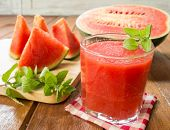 pic of watermelon slices  - Fresh watermelon and glass of watermelon smoothie - JPG