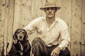 picture of mans-best-friend  - The Farmer and his Best Friend the Dog - JPG