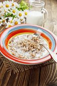 pic of porridge  - Buckwheat porridge with milk in the bowl on the table - JPG