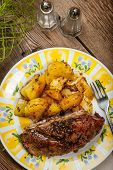 foto of roast duck  - Roast duck breast with potatoes on the plate - JPG