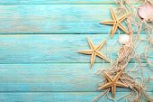 foto of shells  - Sea stars and shells on wooden background - JPG