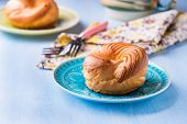 stock photo of custard  - Choux pastry eclair ring with custard cream served for tea selective focus - JPG