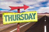 stock photo of thursday  - Thursday sign with road background - JPG