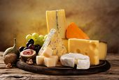 pic of brie cheese  - Various types of cheese on stone table - JPG
