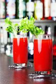 image of bloody  - Two Bloody Mary cocktails shot on a bar counter - JPG