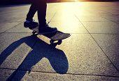 pic of skateboarding  - woman skateboarder legs skateboarding at sunrise city - JPG