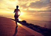 stock photo of japanese woman  - young woman runner  running at seaside - JPG