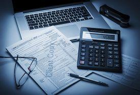 image of calculator  - Tax accounting 1040 US Tax Form - JPG