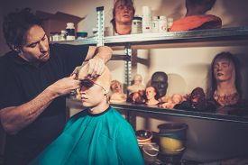 stock photo of prosthetics  - Men during lifecasting process in a prosthetic special fx workshop - JPG