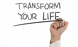 image of transformation  - Motivational concept image of a hand holding marker and write Transform Your Life isolated on white - JPG