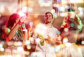 party, holidays, celebration, nightlife and people concept - smiling friends clinking glasses of cha poster