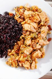 pic of wild turkey  - Turkey with capers and raisins over wild rice