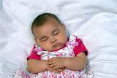 Cute Baby Girl In Pink Sleeping poster