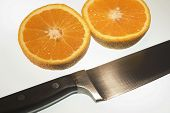 Sliced Orange With Knife