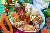 stock photo of mexican food  - Assorted mexican food dish chili sauces papaya tequila - JPG
