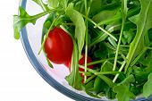 Salad With Rugola And Cherry Tomato In Glass Bowl (Top) With Clipping Path