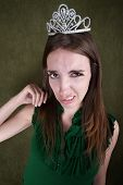stock photo of fidget  - Disgusted Young Woman With A Tiara Crown - JPG