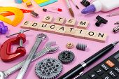 School Equipment With Word Stem Education Over Pink Background In Education Stem Concept. School Des poster