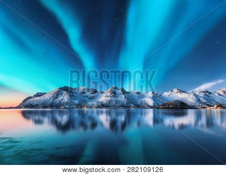 Northern Lights And Snow Covered