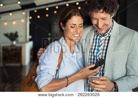 Smiling mature couple embracing while
