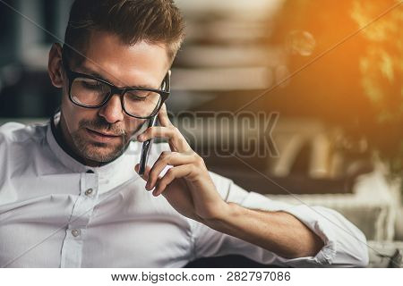 Young Businessman Sitting Relaxed On
