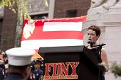 NEW YORK - SEPT 11, 2011: Kate Devlin sings Amazing Grace during ceremony at the Firefighters Memori