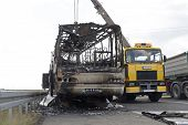 Burned Coach Bus Highway Recovery Assistance After Fire poster