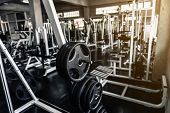 Weights Lifting Rack In Club Fitness Gym., Bodybuilder Equipment Barbell For Shoulders Muscle Exerci poster