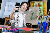 Young Beautiful Smiling Artist Teacher Student Woman Girl Boy In Art Workshop Studio Surrounded By C poster
