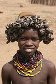 A Young Dasenesh Girl In Traditional Hat, from Ethiopia