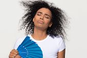African Woman Sweating From Heat Waving Fan Isolated On Background poster
