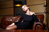 stock photo of snob  - Beautiful elegant woman in a luxury hotel - JPG