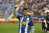 BARCELONA - NOV. 22: Formula1 driver Jaime Alguersuari waves to supporters before a Spanish League m