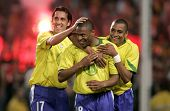 BARCELONA, SPAIN - MAY. 25: Brazilians L-R Edu, Silva and Baptista celebrate goal during the friendl