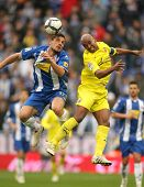 BARCELONA - MARCH 7: Osvaldo(L) of Espanyol fight with Senna(R) of Villareal during a Spanish League