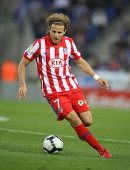 BARCELONA-APRIL 11: Forlan of Atletico Madrid in action during a Spanish League match between Espanyol and Atletico Madrid at the Estadi Cornella on April 11, 2010 in Barcelona, Spain