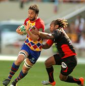 BARCELONA - APRIL 9: Perpignan's Guiry is tackled by Toulon's Gabiriele during the Heineken European