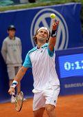 BARCELONA - APRIL 20: Spanish tennis player David Ferrer serves during his match against Gimeno-Traver of   Barcelona tennis tournament Conde de Godo on April 20, 2011 in Barcelona