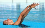 BARCELONA - JUNE 19: Russian olympic swimmer Liubov Leshchik swims a solo exercise during the Espana