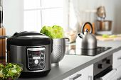 Modern Electric Multi Cooker And Food On Kitchen Countertop. Space For Text poster