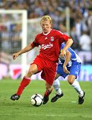 BARCELONA - AUGUST 2: Dirk Kuyt, Dutch player of Liverpool FC, in action during a friendly match aga