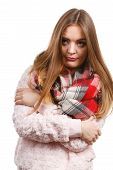 Fashion, Clothes And Clothing Concept. Grumpy Woman Feeling Cold Wearing Warm Scarf Warming Herself  poster