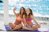 Sexual Girl In A Bright Bikini On A Sunny Beach. Bikini, Red Lips, Blue Sea, Tanned Girl. Two Friend poster