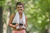 Sport Woman With Towel Jogging And Running In Park In City Center poster