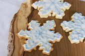three iced snowflake cookies