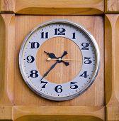 Clock In Wooden Box Showing Twentyseven Past Nine.