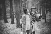 Couple In Love Hiking In Forest With Touristic Equipment, Trees On Background, Defocused. Man With W poster