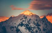 Mountain top colorful sunet, Antarctica. The sunlit snow covered range. Breathtaking polar scenery.  poster