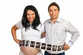 Couple With Many Sonogram Images
